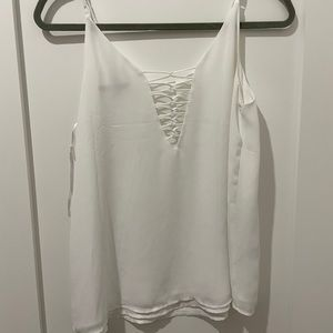 Flowy white lace-up satin blouse